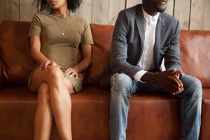 african american couple sitting on the couch while considering divorce before counseling for life transitions in Baltimore, MD 21210. Get help for divorce therapy at New Connections Counseling Center