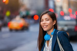 Young professional Asian woman wearing headphones in the city of Baltimore, MD | Treatment for Sexual Assault | Therapy for Sexual Assault | Counseling | Mental health help 21210