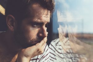 man suffering from depression during coronavirus