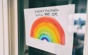 "Image of a white sign on a window with a rainbow and the words ""everything will be ok."" This image represents the support that LGBTQIA+ folks can receive in LGBTQ therapy in Baltimore, MD. An LGBTQ affirming therapist in Baltimore, MD can help you learn about your identity. 