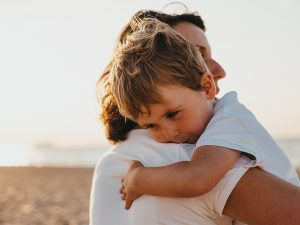 Single mother hugging her kid | New Connections Counseling Center, Baltimore, MD